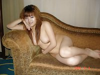Cute hairy asian girl shows her naked body